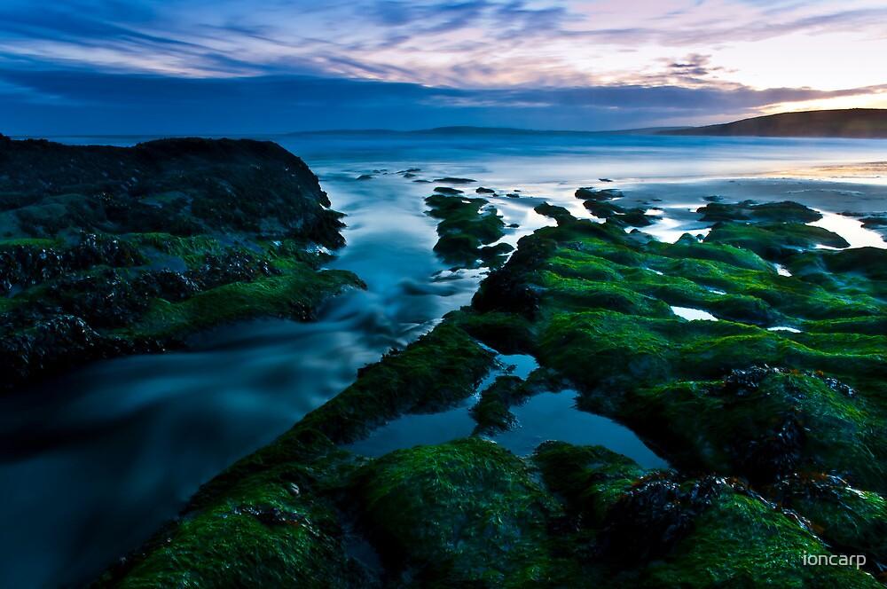 beach on sunset by ioncarp