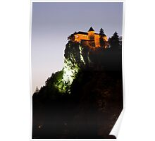 Bled castle lit up at night Poster