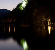 Lake Bled castle reflected at dusk by Ian Middleton