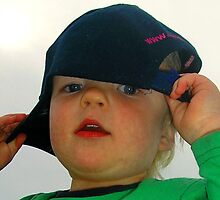 Trying on his Daddy's cap! by Photography by  Carolyn