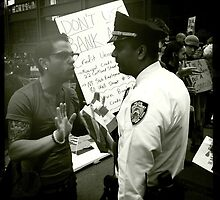Occupy Wall Street - Protester and Officer 10/5/2011 by Kristina Gale