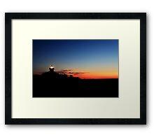 Lighthouse at morning twlight Framed Print