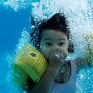 Young Girl Diving In A Swimming Pool Underwater by Sami Sarkis