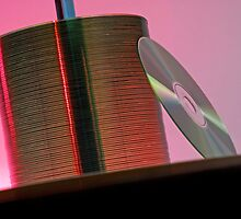 CD leaning against stack of CD's by Sami Sarkis