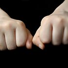 Boy's (10-12) fists, close up by Sami Sarkis