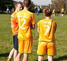 Soccer Team Mates Watch Game by Robert Noll