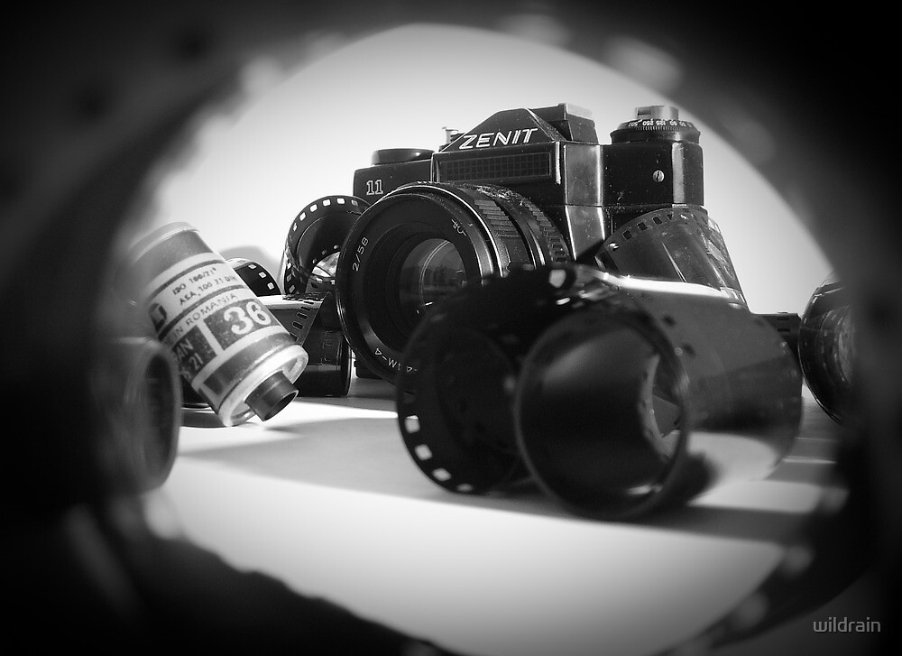 Zenit camera and 35mm film  by wildrain