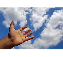 Mans hand reaching for clouds Photographic Print