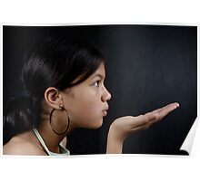 Girl blowing palm of hand Poster