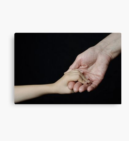 Senior woman holding little girl's hand Canvas Print