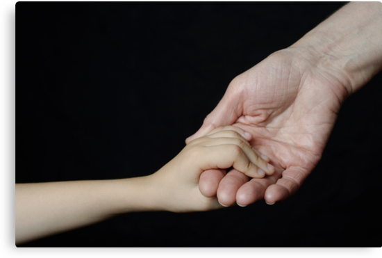 Senior woman holding little girl's hand by Sami Sarkis