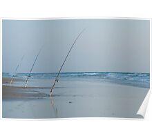 Three fishing rods on beach Poster