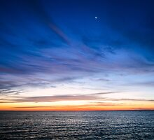 Sunrise with a Slice of Moon by MarjorieB