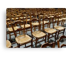 Row of chairs in church Canvas Print