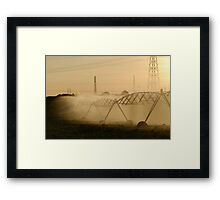 Sprinklers spraying water in field Framed Print