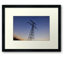 Electricity pylons in field Framed Print