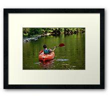 Boy kayaking in river Framed Print