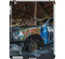 Abandoned car in an abandoned warehouse iPad Case/Skin