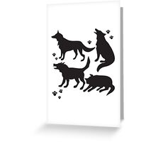 Hand drawn sketch set of wolves silhouettes on white background. Greeting Card