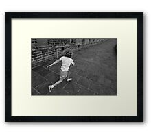 Girl running away on Great Wall of China Framed Print