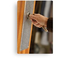Woman opening front door with key Canvas Print