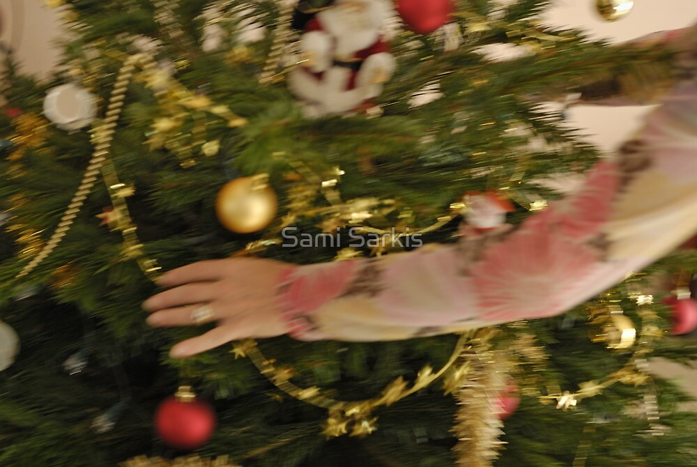 Woman decorating Christmas tree by Sami Sarkis