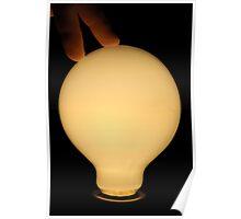 Fingers touching illuminated light bulb Poster