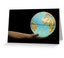 Man offering illuminated Earth globe Greeting Card