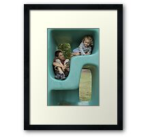 Boy (11-13) and girl (5-7) playing in plastic cube Framed Print