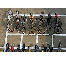 Bicycles parked on street Photographic Print