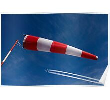 Windsock and airplane against sky, low angle view Poster