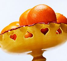 Oranges in bowl by Sami Sarkis