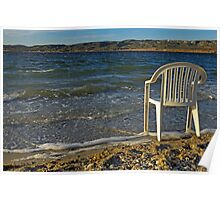 Plastic chair on water edge on beach Poster