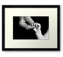 Father holding hand of baby Framed Print