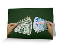 Man holding fanned out US dollars and Euro banknotes Greeting Card