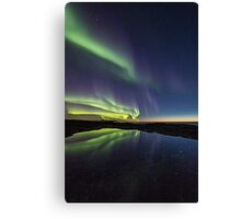 Sunset and northern lights Canvas Print