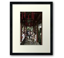 a narrow walk Framed Print