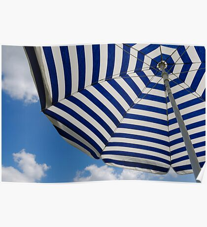 Striped beach umbrella against blue sky Poster