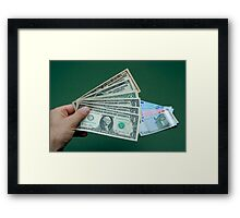 Man's hand with US banknotes, Euro banknotes on table Framed Print