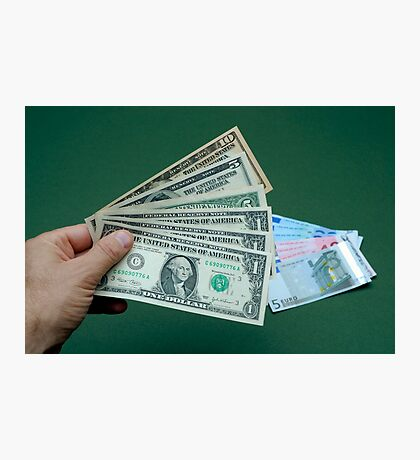 Man's hand with US banknotes, Euro banknotes on table Photographic Print