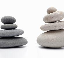 Two stacks of white and gray pebbles, studio shot by Sami Sarkis