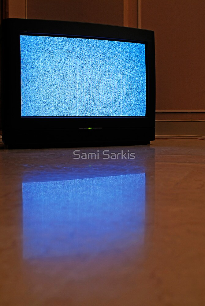 Television displaying static reflected on floor by Sami Sarkis