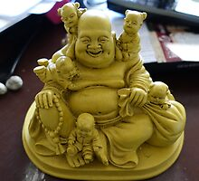 Laughing buddha stone statue. by naturematters
