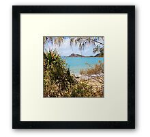 Tranquil bay through the trees Framed Print
