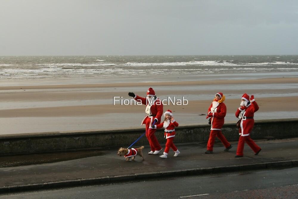 Santas going for a walk by Fiona MacNab