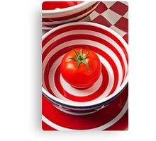 Tomato in red and white bowl Canvas Print