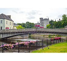 flower lined riverside railings view Photographic Print