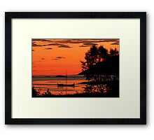The old boat under the rising sun Framed Print