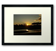 Setting sun over Skogskyrkogården Framed Print