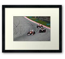Ferarri's Massa overtakes Lotus Renault's Petrov Framed Print